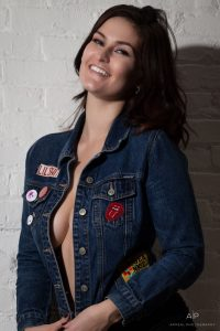 Our Aspiring Model, Julia Annette, lets her personality shine through in this shot, featuring her authentic, infectious smile and the jeans jacket she wore to the studio